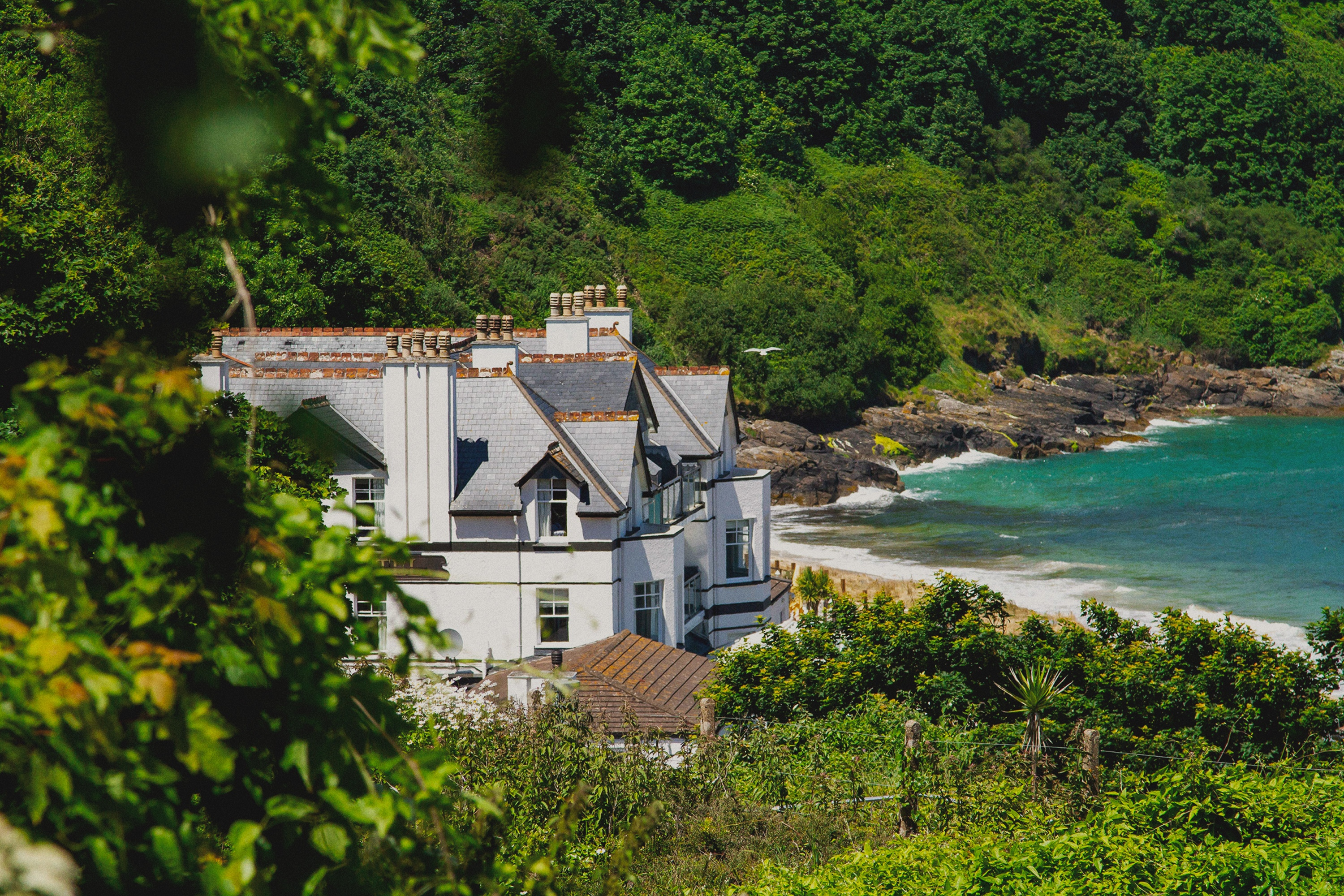 Shot of Carbis Bay Estate amongst trees.
