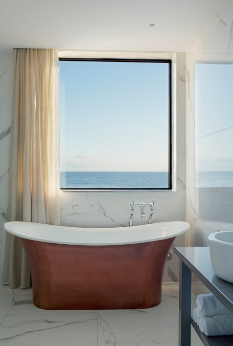 Carbis Bay Lodge bathroom with view through window.