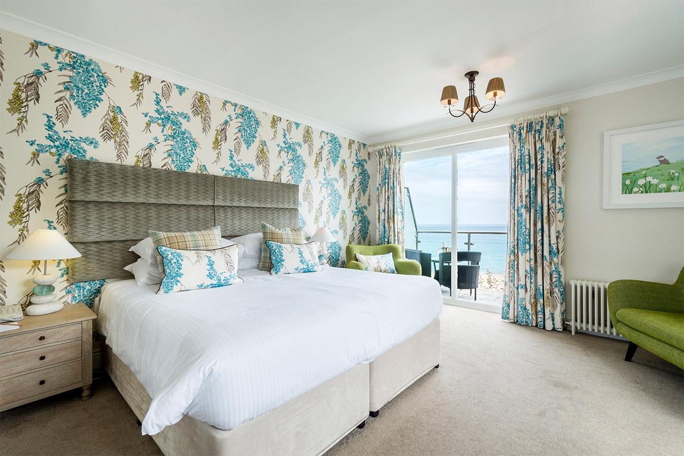 Cream and blue themed bedroom overlooking Carbis Bay.