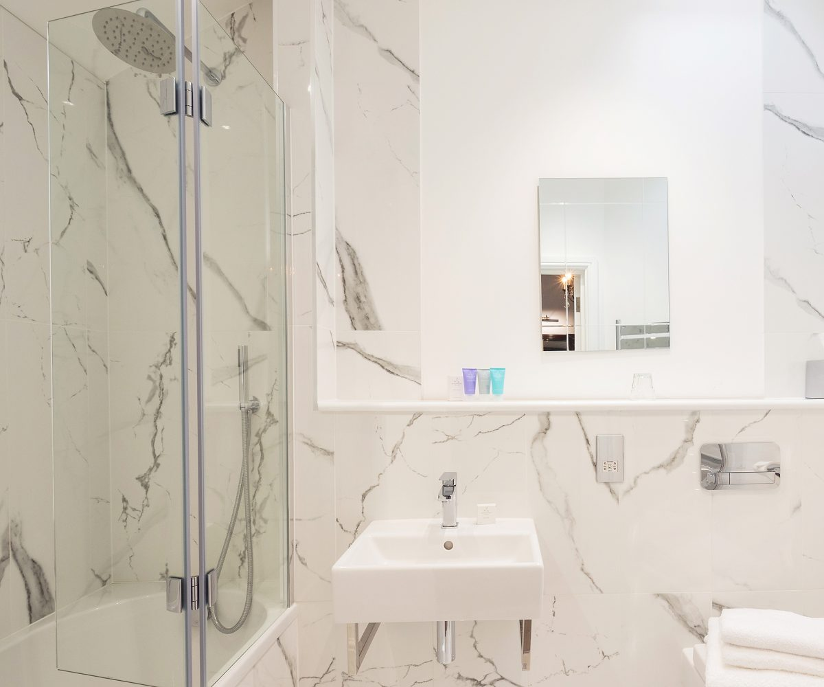 White bathroom with marbling effect.
