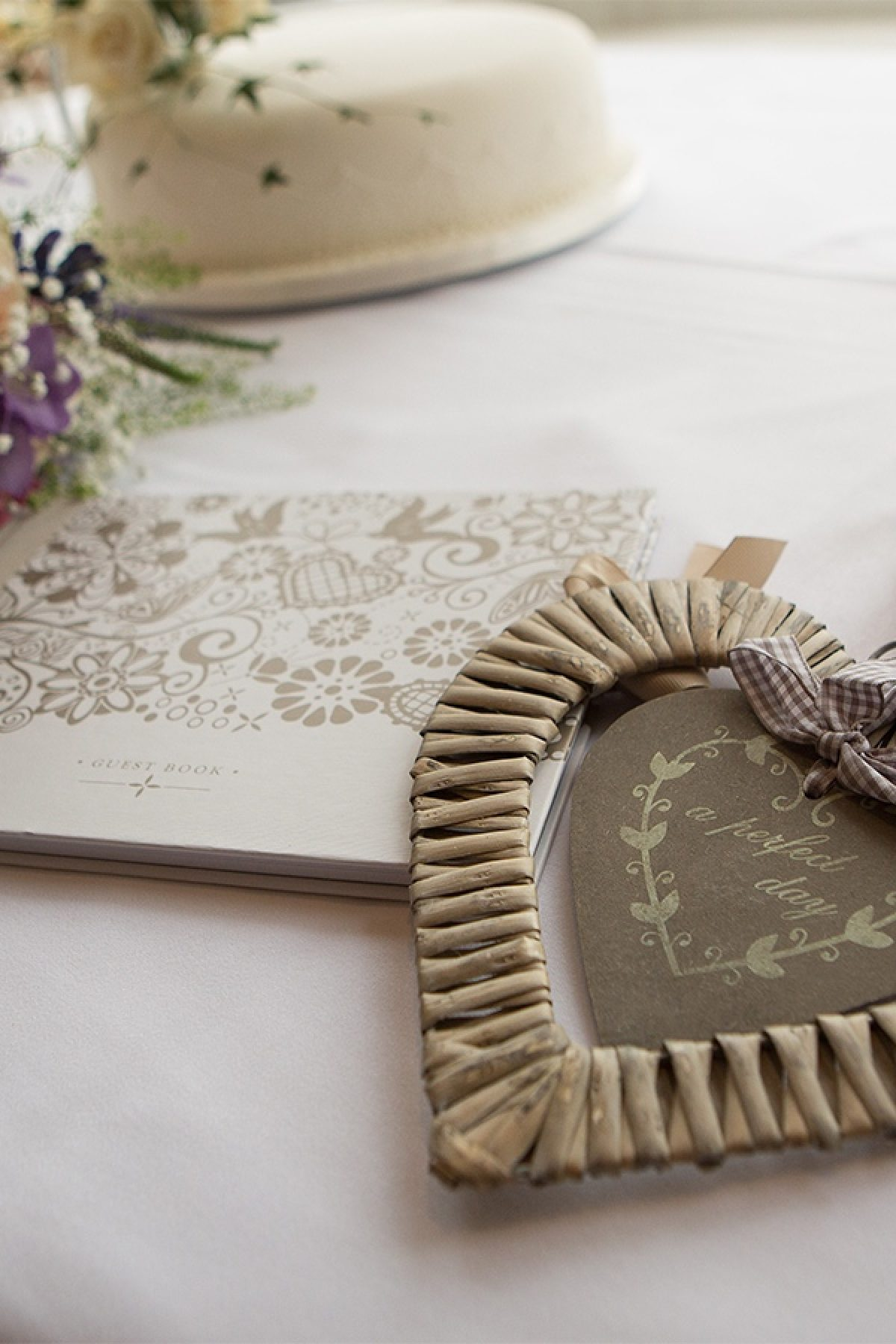 Wooden horse shoe and heart laid on table with white cloth.