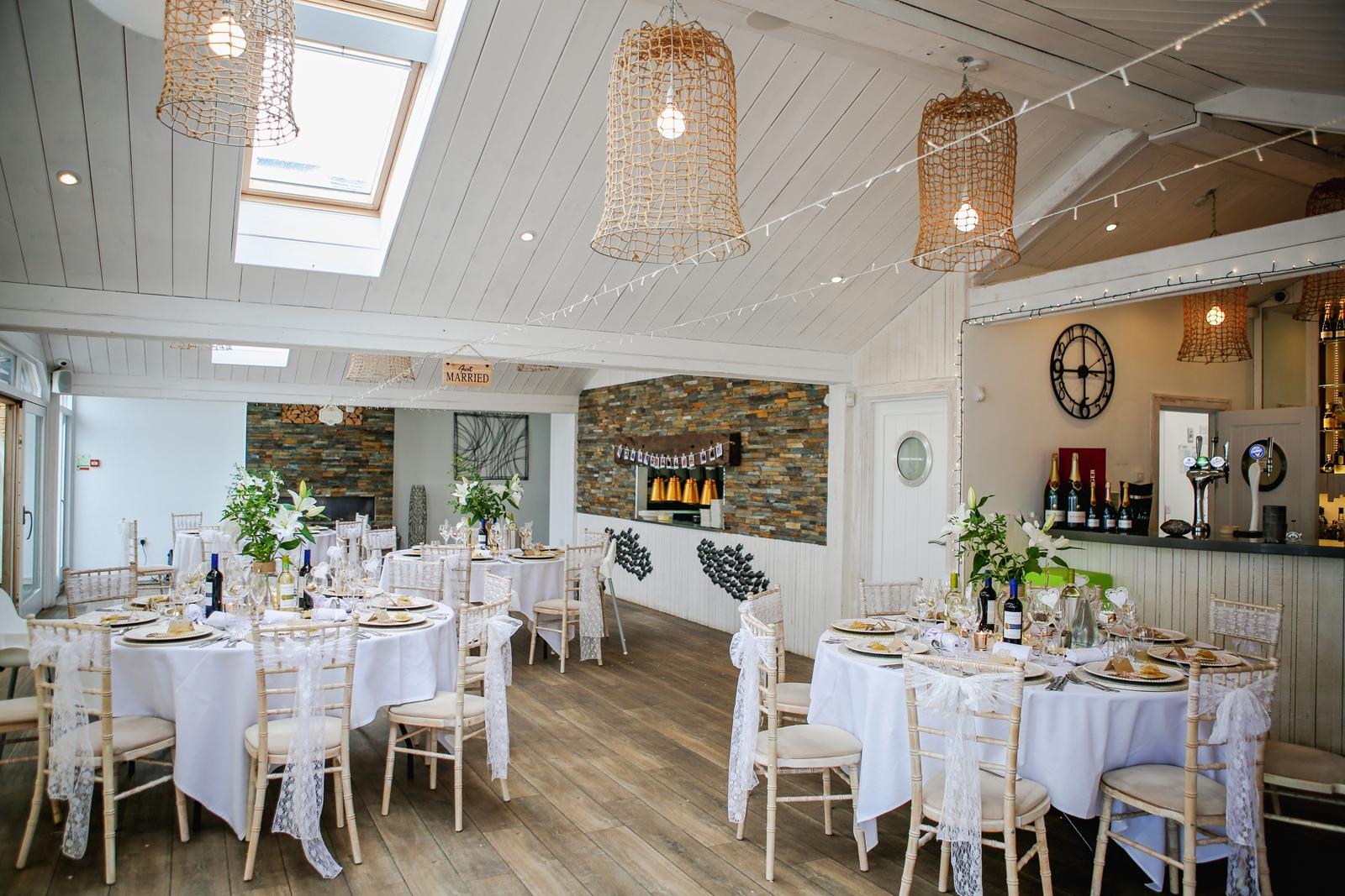 Wedding party seating under skylight window.