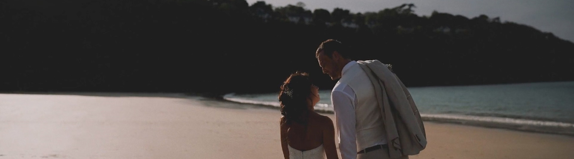 Newlywed couple on Carbis Bay beach.